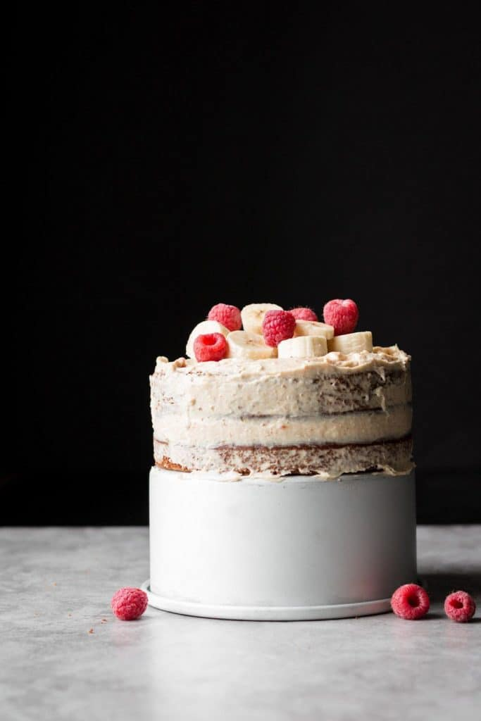 Spiced Banana Cake with Cream Cheese Frosting and raspberries