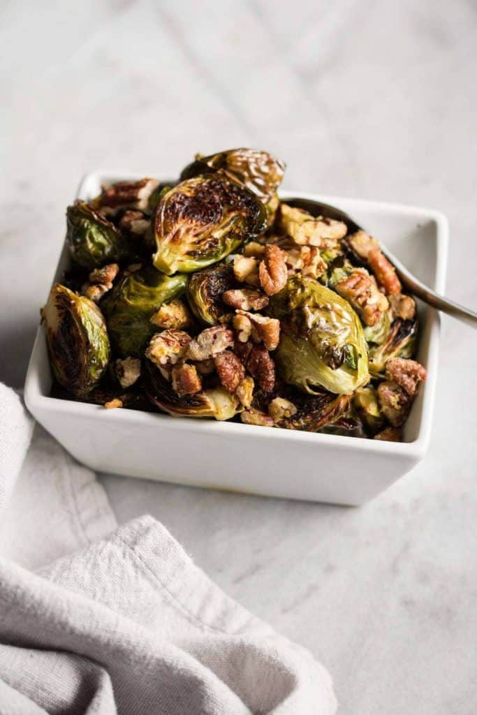 Roasted Brussels Sprouts with Garlic Pecans in a dish