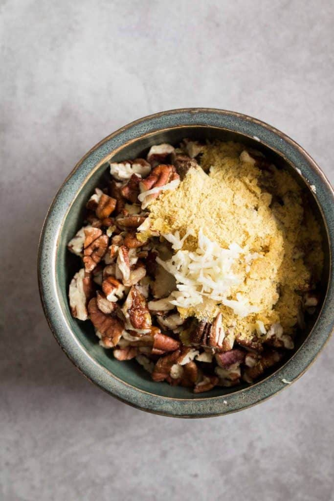 pecans, garlic and nutritional yeast in a bowl