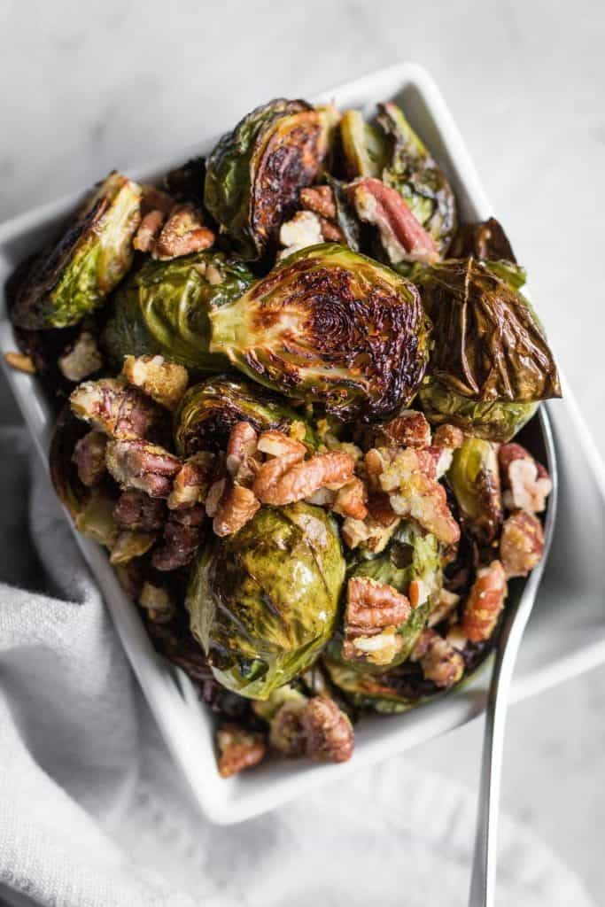 roasted brussels sprouts with pecan parmesan in a dish