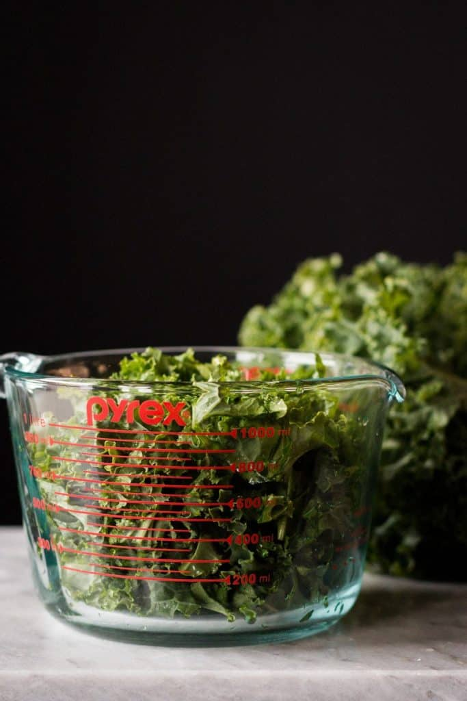 kale in a measuring cup