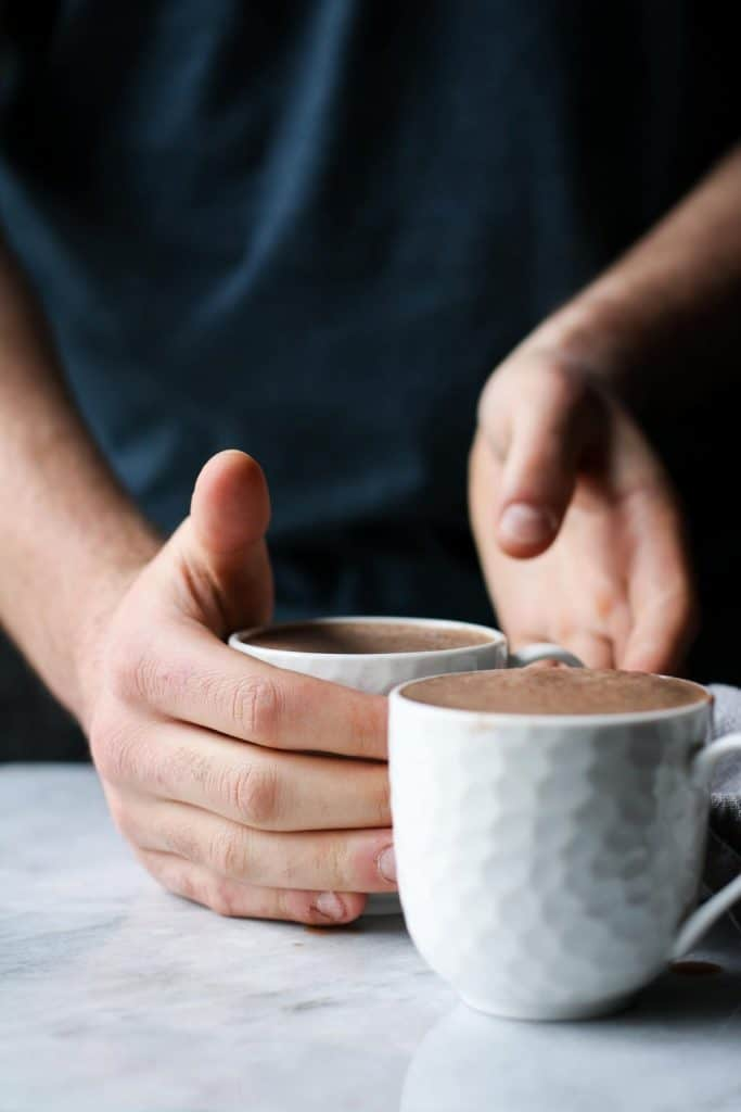 hands reaching for cup