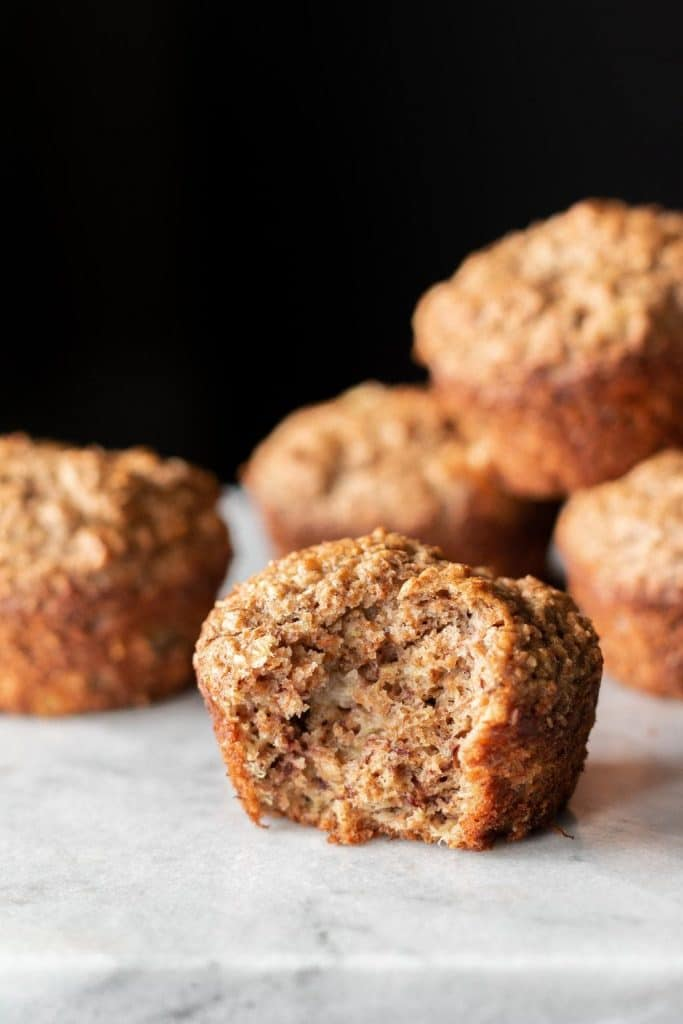 bran muffin with bite taken from it