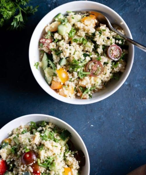 summer quinoa salad in two bowls from the top