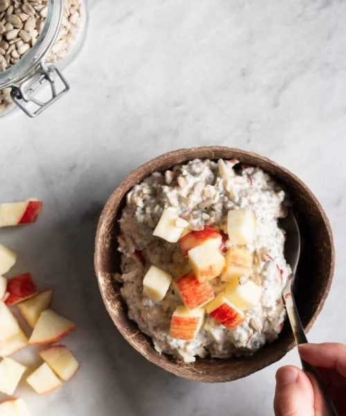 apple muesli in a bowl from top