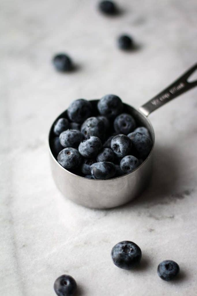 blueberries in a measuring cup