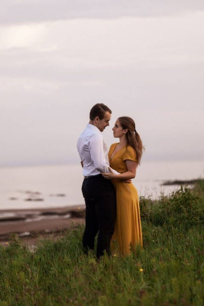 couple hugging in the tall grass