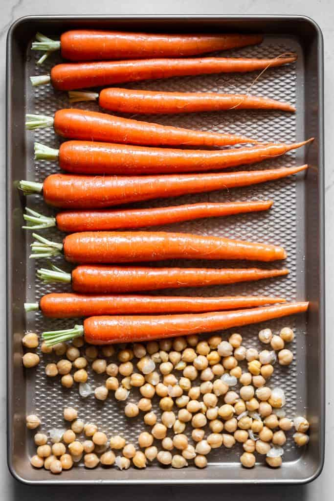 carrots and chickpeas on a pan