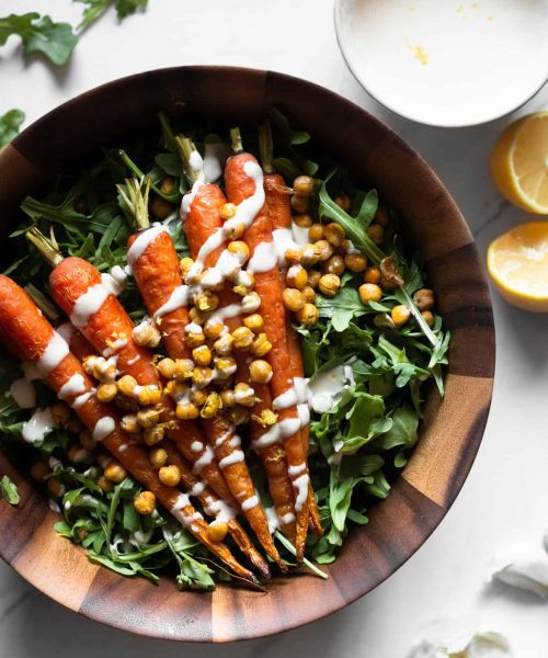 carrot and arugula salad in bowl