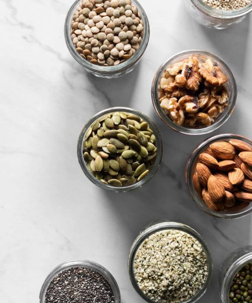 nuts, seeds and legumes in jars from the top