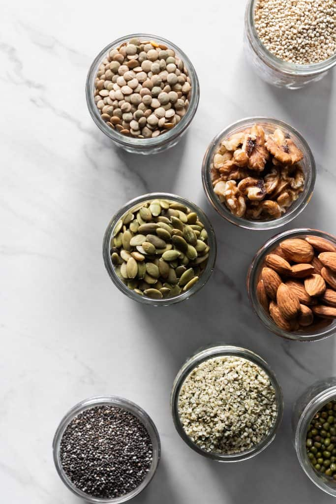 beans, nuts and seeds in jars from the top