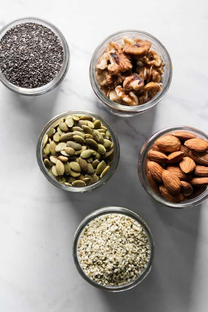 nuts and seeds in jars from the top