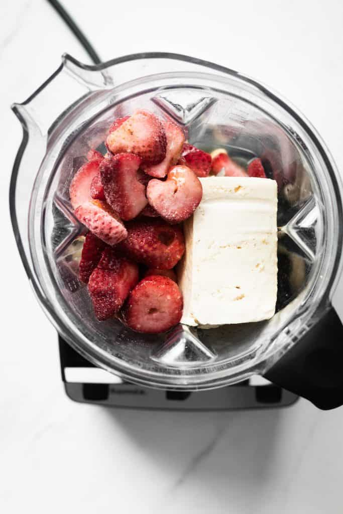 tofu and berries in a blender