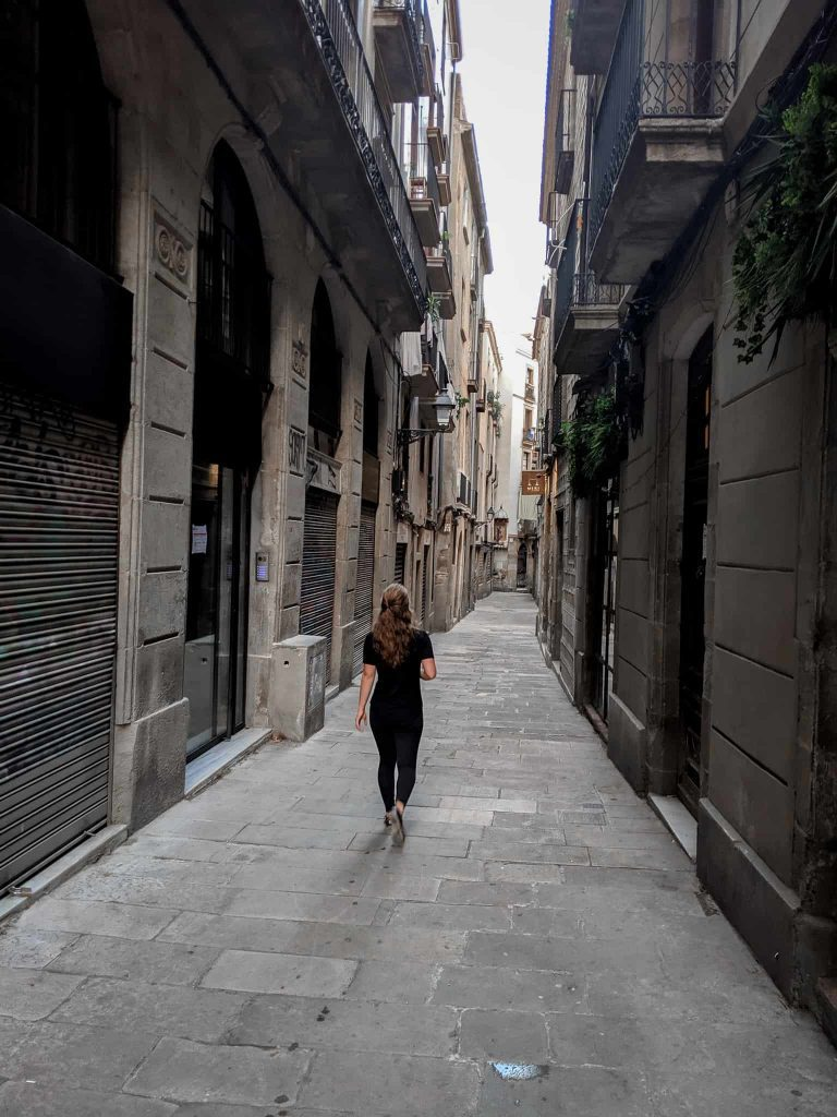 Girl walking in empty street