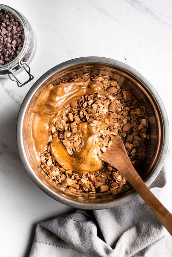 granola ingredients combined in a bowl