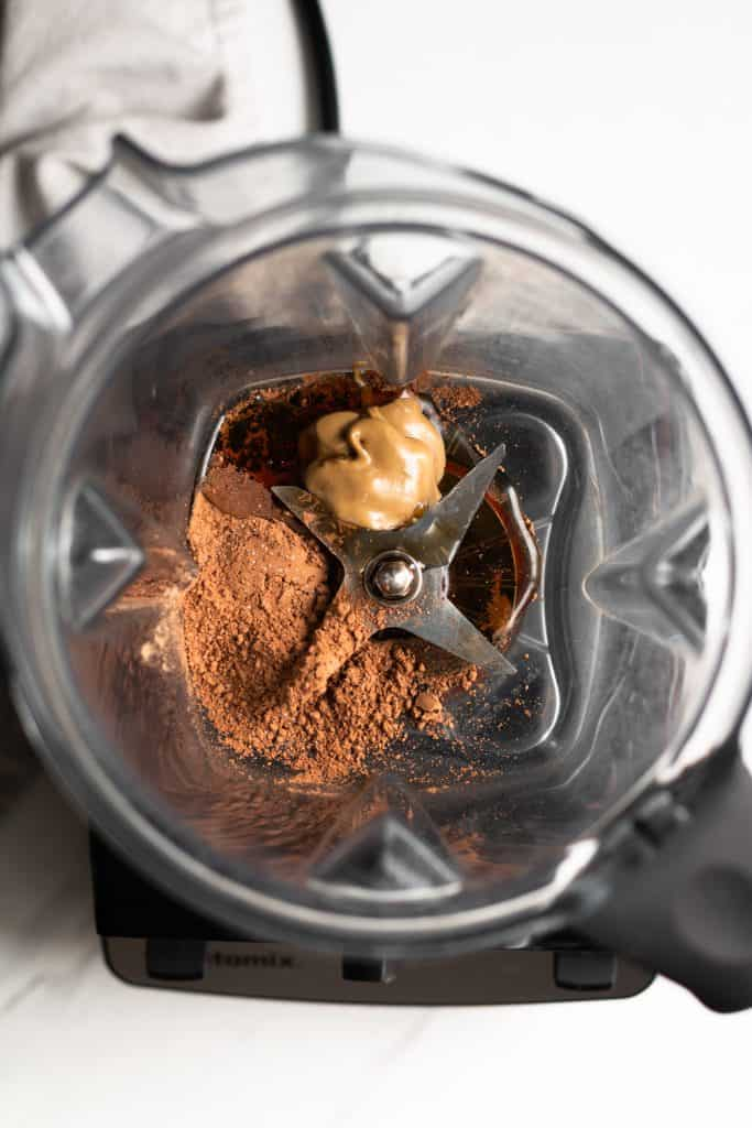 cocoa powder, sunflower seed butter and maple syrup in a blender