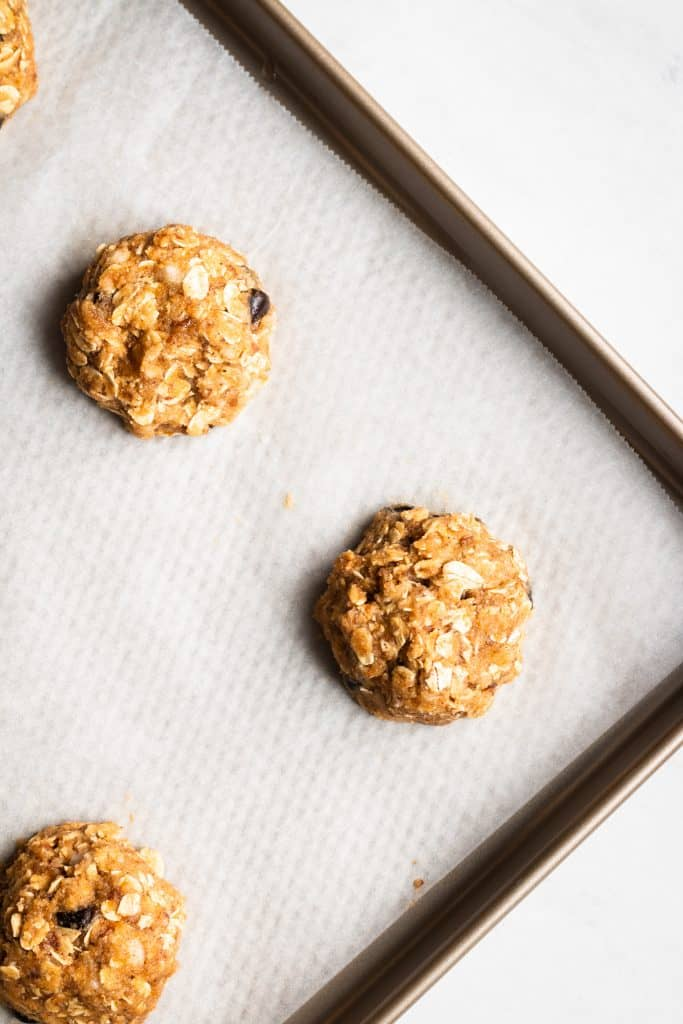 unbaked pumpkin chocolate chip cookies on a baking sheet