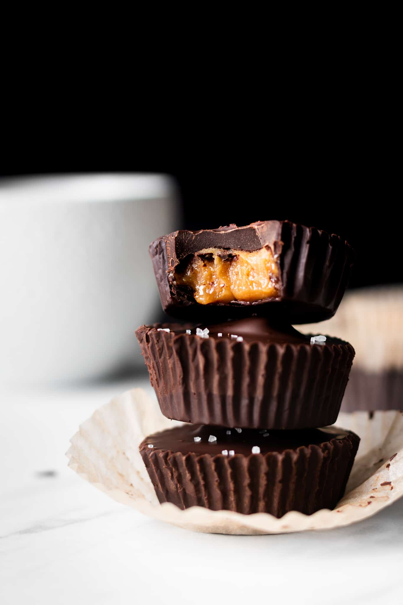 chocolate caramel peanut butter cups with bite taken