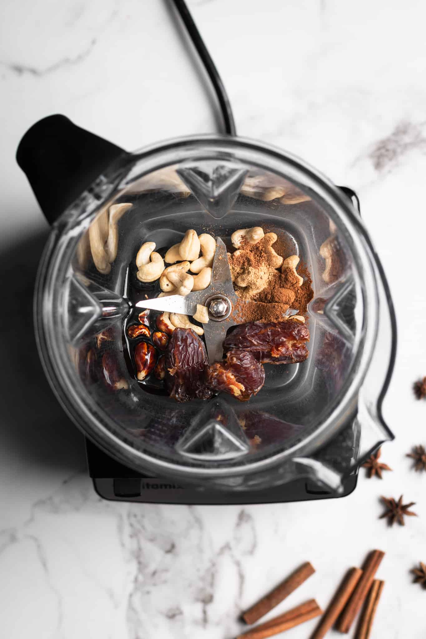dates, cashews and spices in a blender