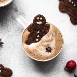 gingerbread latte in a cup with gingerbread men