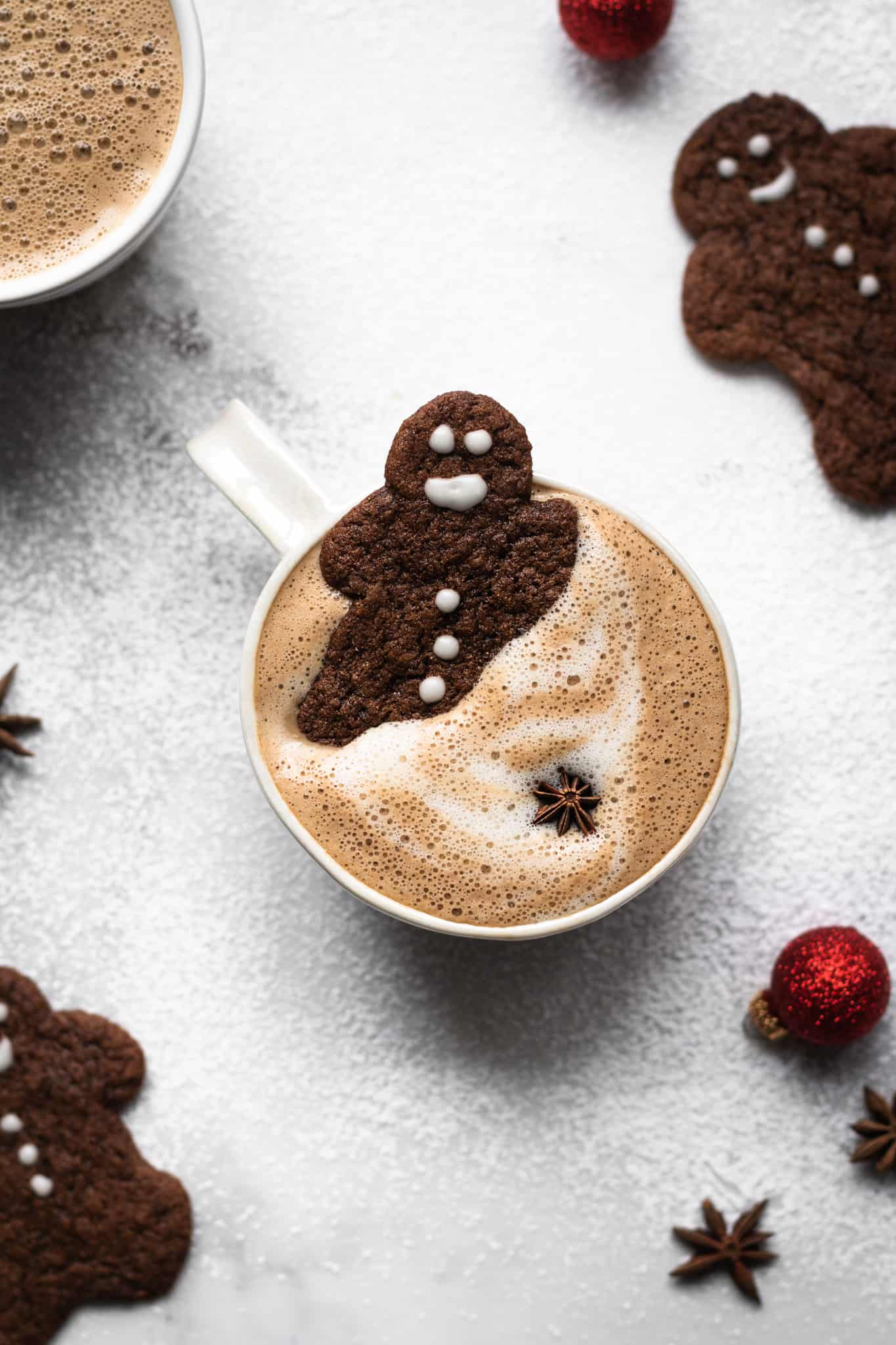 gingerbread latte in a cup with gingerbread man