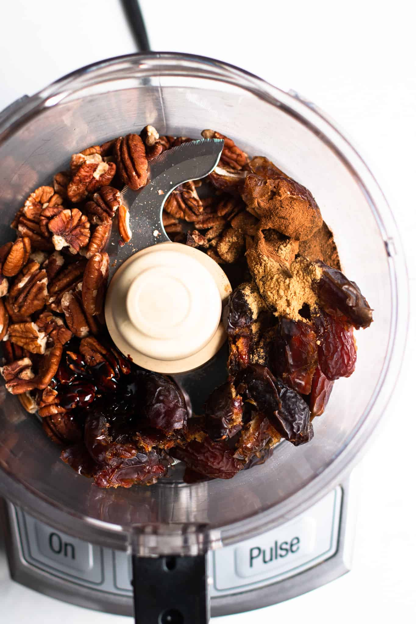 dates, pecans and spices in a food processor