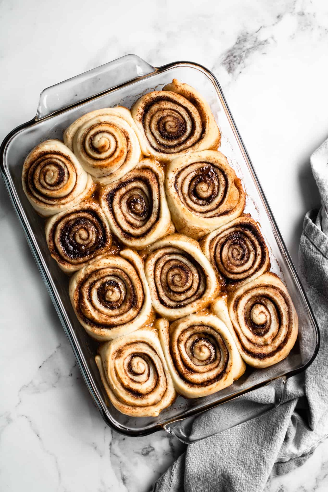 Baked cinnamon rolls in a glass dish