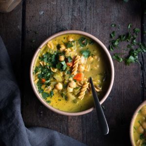 creamy chickpea noodle soup in a bowl
