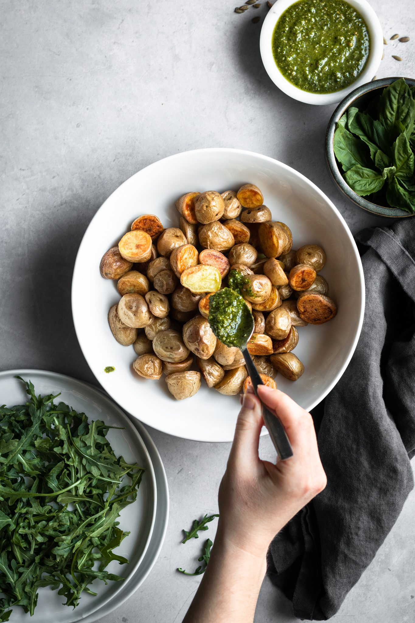 roasted potatoes in a bowl with pesto
