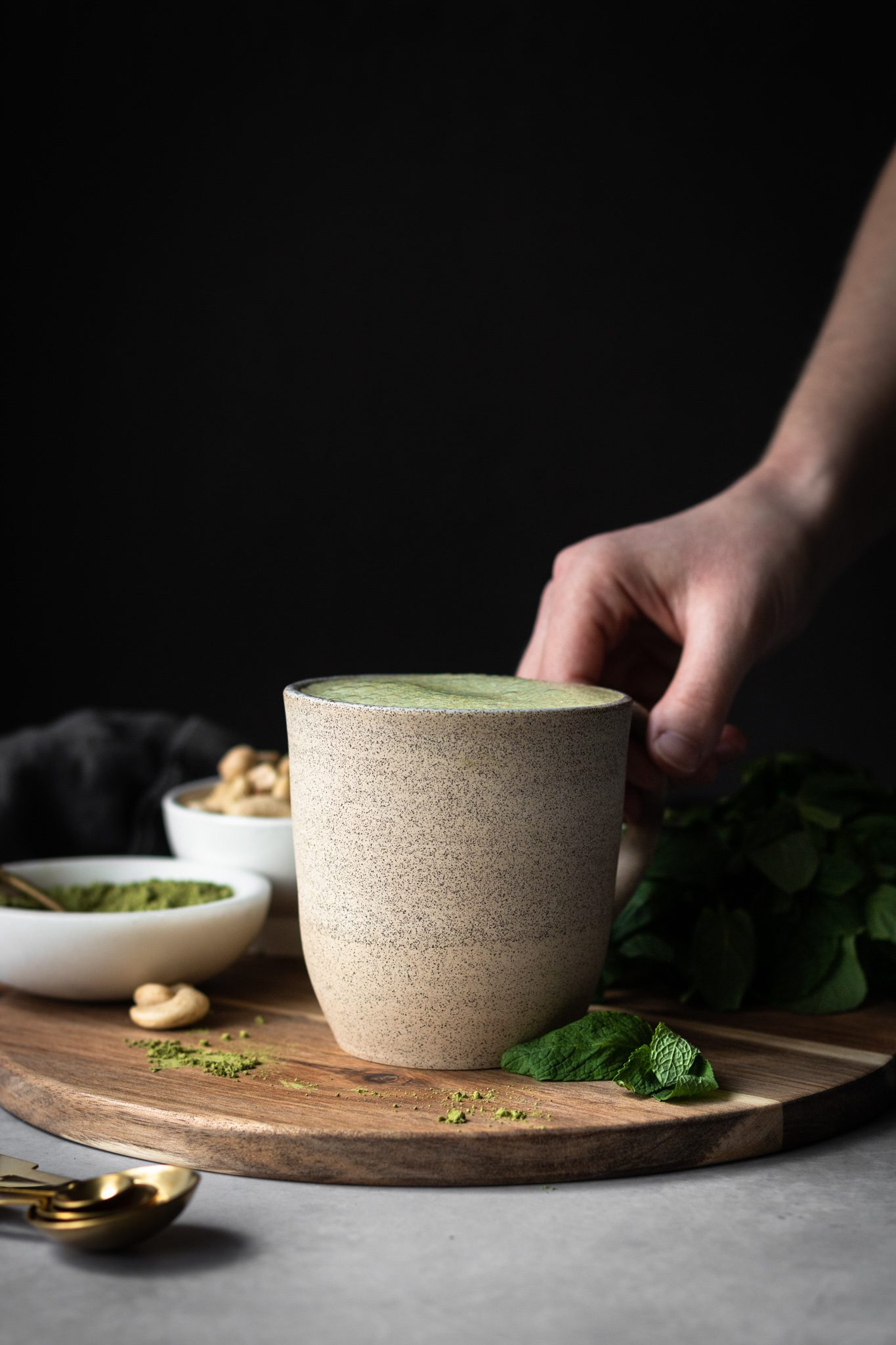 hand holding cup of mint matcha