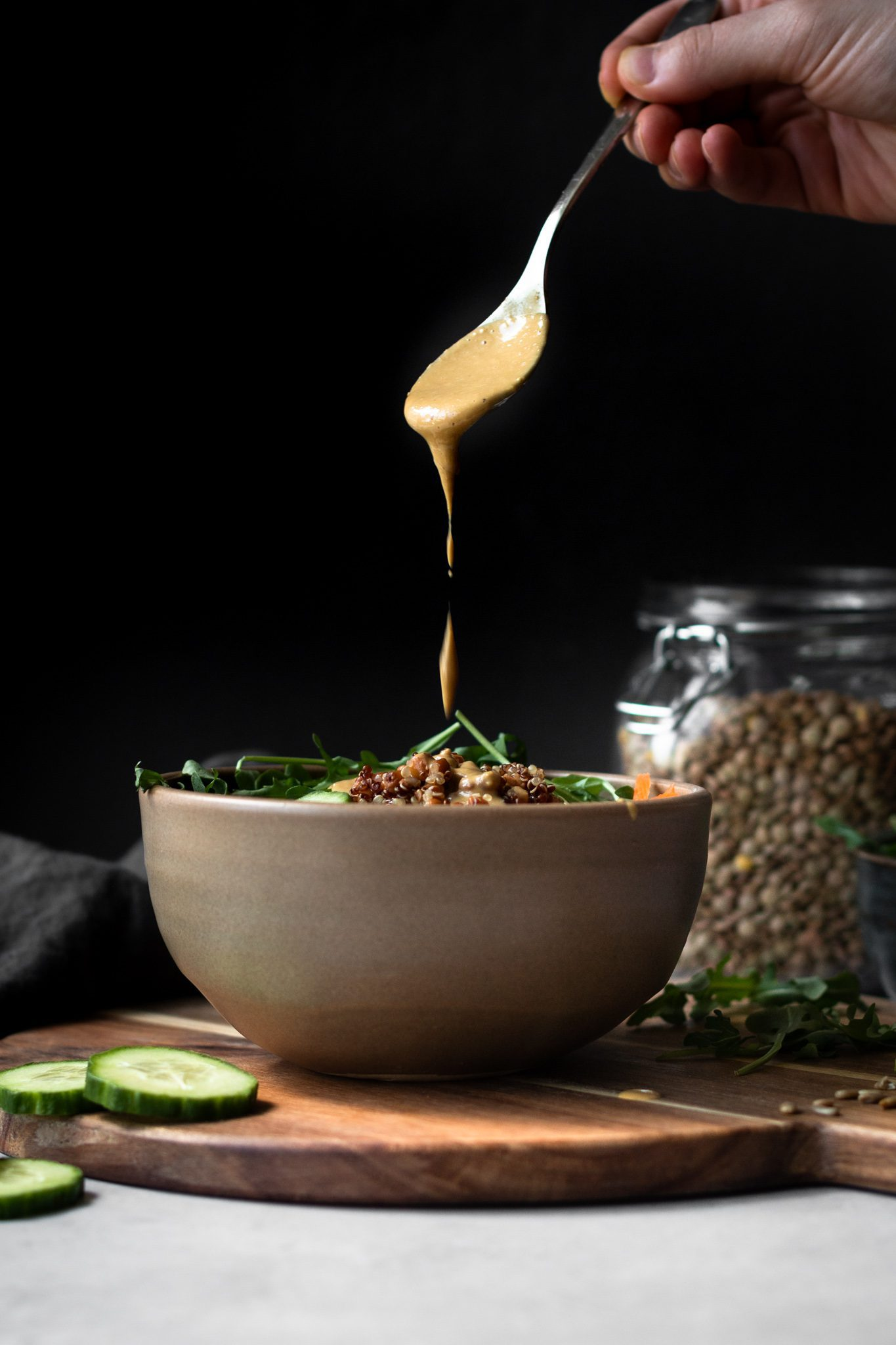 Nutritional yeast dressing drizzled over salad
