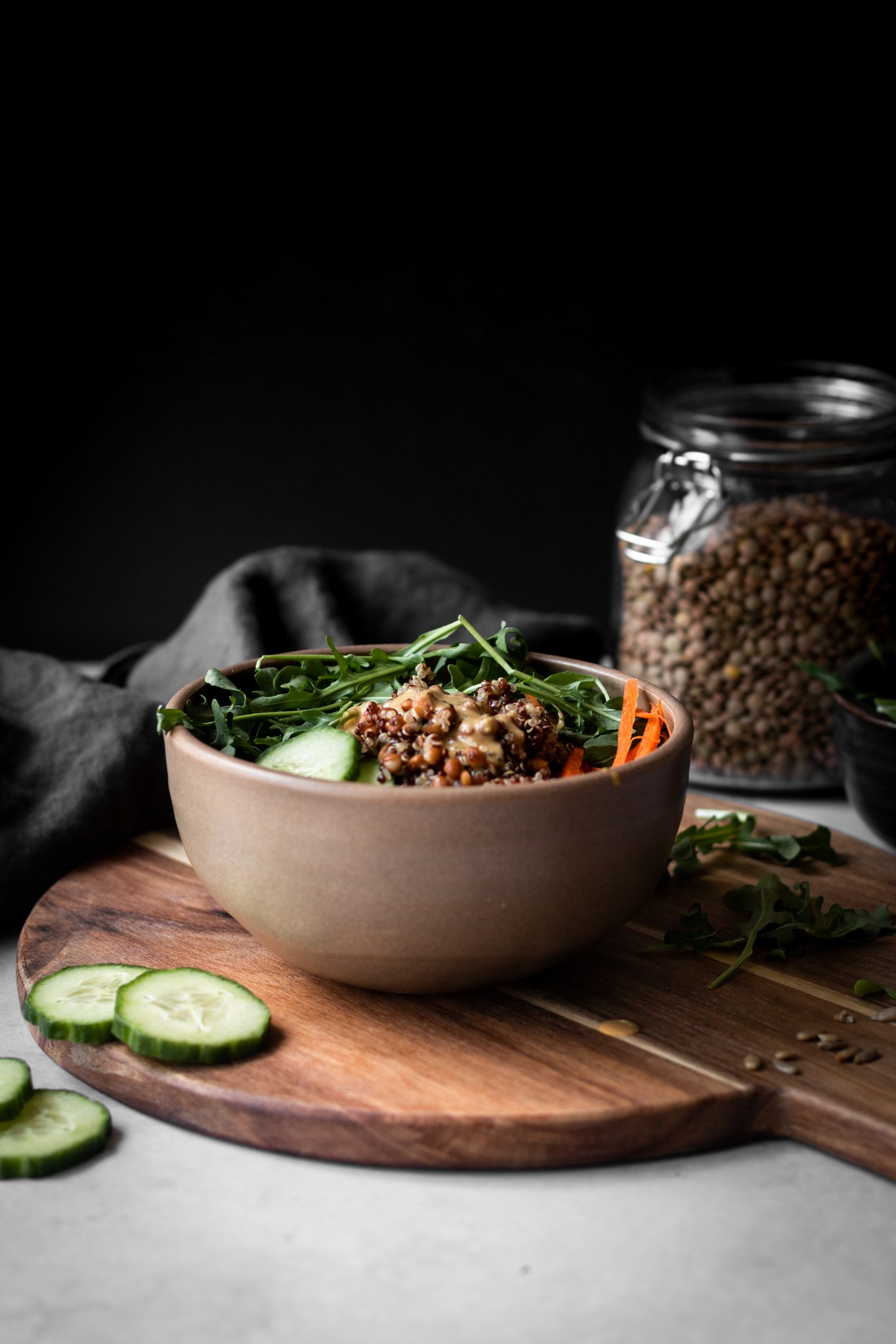 lentil quinoa salad in a bowl from the side