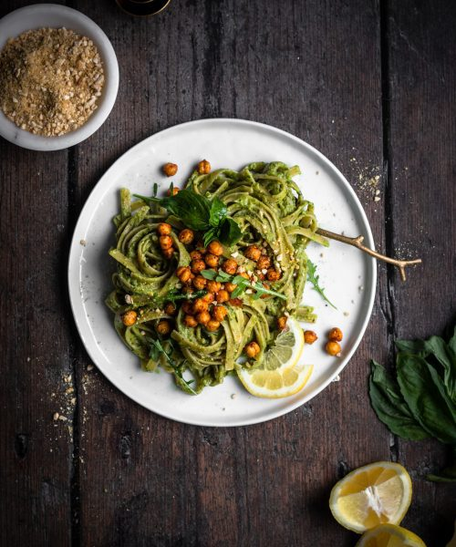 vegan avocado pesto pasta on a plate with chickpeas