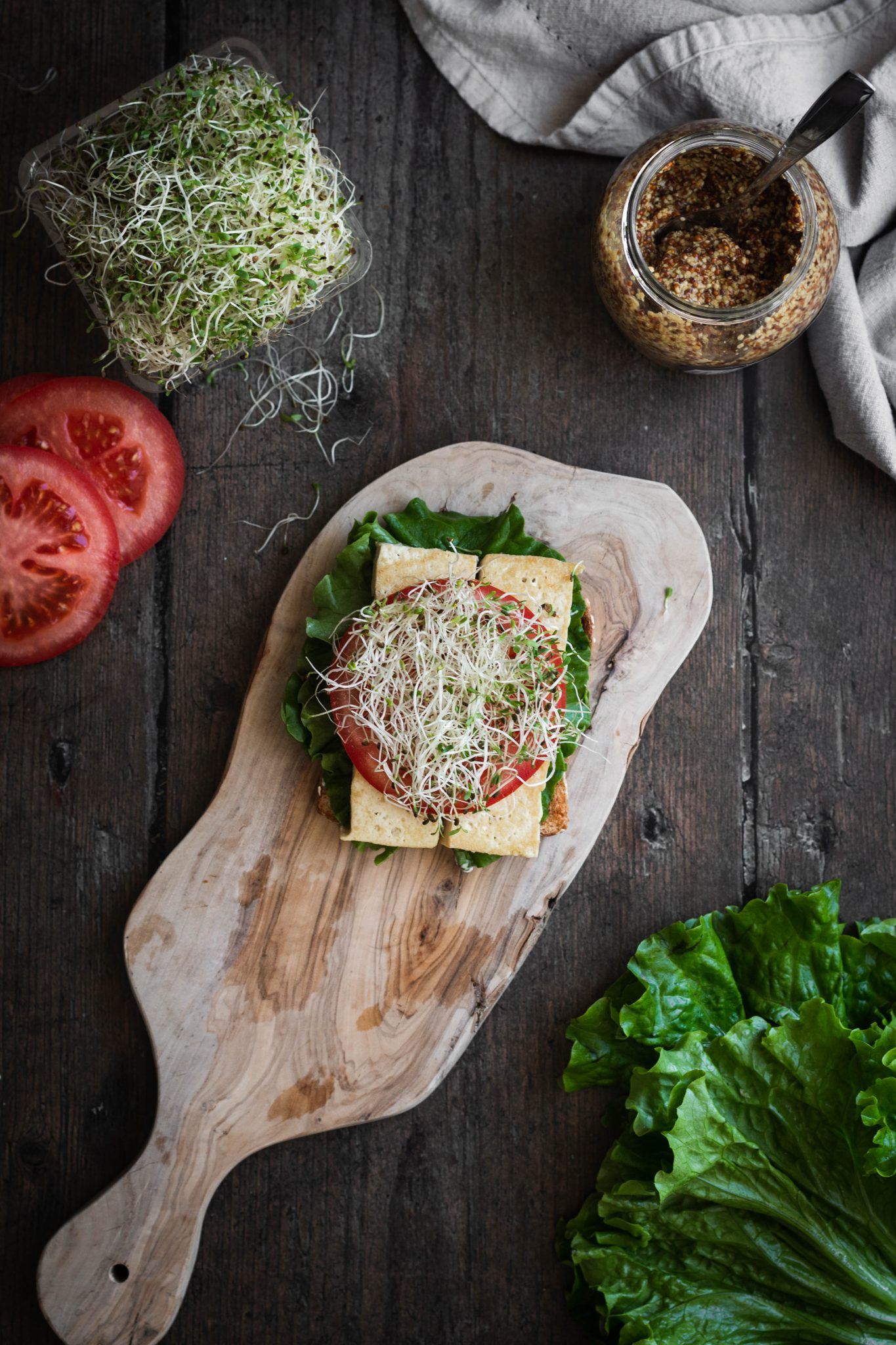 open-faced tofu sandwich with vegetables