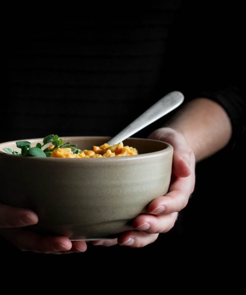 hands holding a bowl of soup - tips to improve your health without dieting